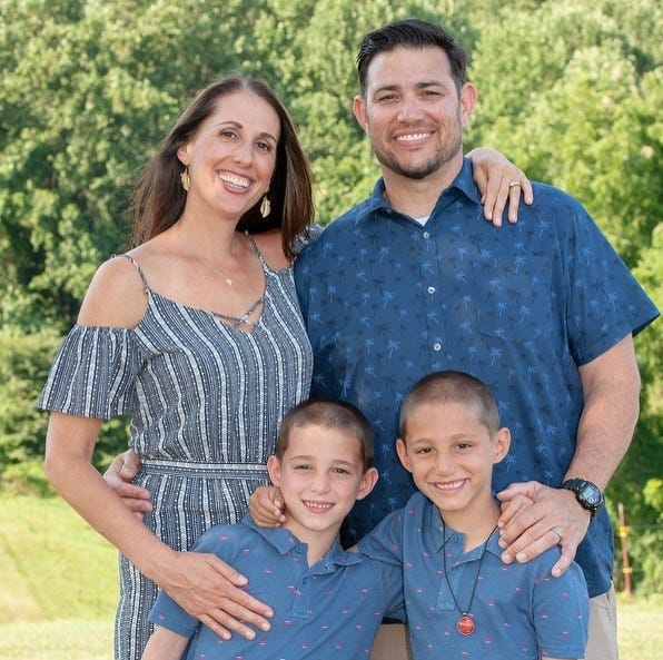 Juliet Xifaras, her husband Tom and twin sons Thomas and Theodore are hopeful for more good news as Thomas, bottom left, recovers.