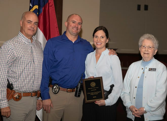 Sheriff Chip Hughes, left, poses with Nikki McKee, the New Bern Civitans Law Enforcement officer of the year. Standing with her is her husband, Brad McKee, and Civitans Helen Shine. [Bill Hand / Sun Journal Staff]