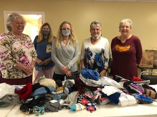 Torchbearer Zeta, chapter of the international sorority Beta Sigma Phi, recently donated socks, scarves, gloves, and hats to Veterans Stand Down of Craven County. Mrs. January Brown, Family Caregiver Resource Specialist, accepted the donations. The items will benefit homeless veterans. Pictured are members Dean Roberts, Martha Oyan, Veterans Stand Down representative January Brown, and members Connie Stoermer and Sandy Chambers. [CONTRIBUTED PHOTO]