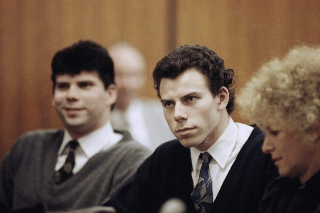 Lyle, left, and Erik Menendez sit with defense attorney Leslie Abramson, right, in Beverly Hills Municipal Court during a hearing, Nov. 26, 1990. The  two brothers were charged in the August 1989 shotgun murders of their parents Jose and Kitty Menendez.