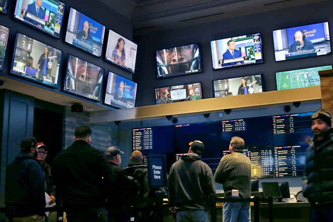 Patrons visit the sports betting area of Twin River Casino in Lincoln, Rhode Island.