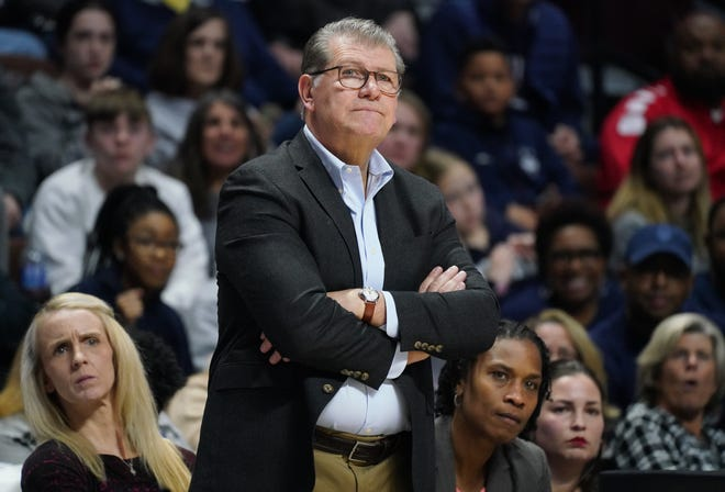 The first four games of the UConn women's basketball season have been postponed for coach Geno Auriemma and his Huskies.
