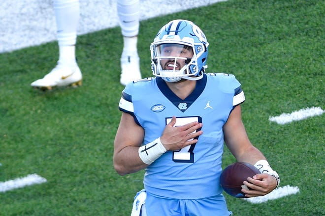 North Carolina Tar Heels quarterback Sam Howell reacts after scoring a tochdown earlier this month.