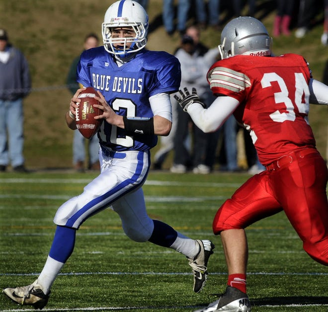 Leominster's Garrett DelleChiaie rolls out to throw against Fitchburg during their 2012 Thanksgiving contest.