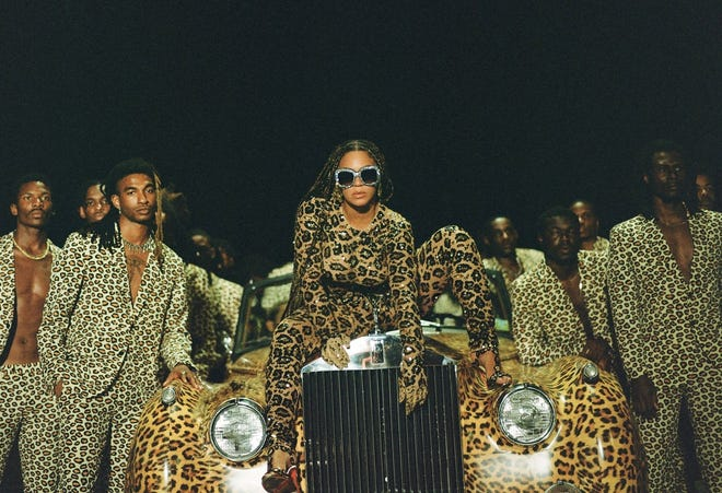 """Beyonce Knowles, center, in a scene from her visual album """"Black is King."""""""