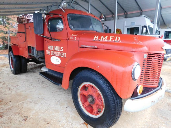 Santa Claus is scheduled to make an appearance on this vintage Hope Mills firetruck. [CONTRIBUTED PHOTO]