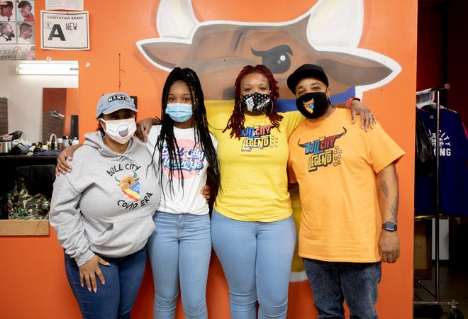 From left, Zuri Hester, Jakayla Gibbs, Sabrina Hester, and Akili Hester stand for a portrait after an interview about their experience quarantining together in the same household for about two months while Sabrina recovered from COVID-19, on Friday Oct. 30, 2020, in Durham, N.C.