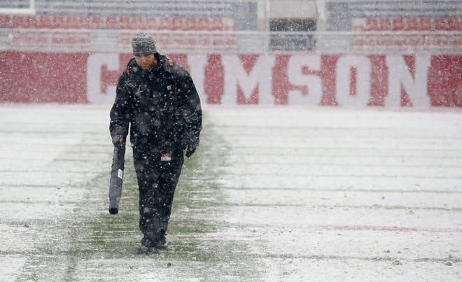Casey Kyle,a University of Alabama grounds crew member works to clear snow in Bryant-Denny Stadium before the beginning of the Super 7 state football champion games Friday, December 8, 2017. [Staff Photo/Gary Cosby Jr.]