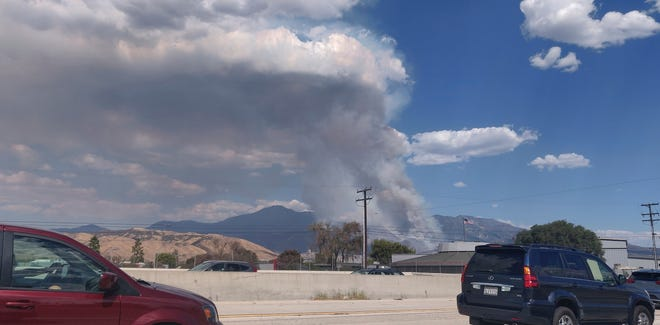A plume of smoke from the El Dorado Fire is seen from Interstate 10 in Loma Linda on Saturday, Sept. 5, 2020.