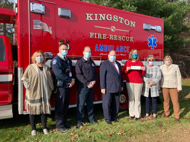 Selectman Kim Emberg accepts a $473,014.33 CARES Act check joined by Monica Mullen for Sen. Susan Moran, Deputy Fire Chief Adam Hatch, Fire Chief Mark Douglass, Plymouth County Treasurer Tom O'Brien, Plymouth County Commissioner Sandra Wright and Interim Town Administrator Gloria Mitchell.