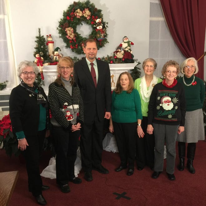 Mayor Robert Hedund, greets members of the  Weymouth Garden Club after they decorated his office for the 2016 annual holiday fundraiser in December 2016. Pictured, from left: Michelle DeLorey Cappellini, Andrea Feeney, Mayor Robert Hedlund, WGC President Jean Berg, Carmela Rihn, Ellie Reppucci and Mary Dorey.