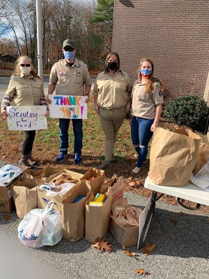 Pictured, from left, are Cub Scout food drive volunteers Deborah and Don Lee, Meaghan Williamson and Kim Cato at Francis J. Kane Elementary School.