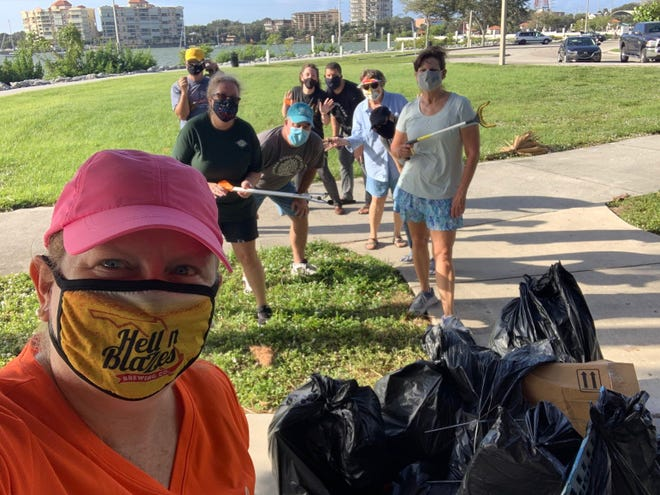 Connie Harvey, right, wielding a trash picker, recently joined a Keep Brevard Beautiful cleanup organized by Kaitlyn Aliano-Weisberg in Cocoa's Lee Wenner Park. But she doesn't wait for group cleanups to pick up litter.