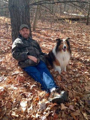 Brady Walker and his dog, Sully, in 2014 at Livonia's Rotary Park. Walker still attends the Beyond the Paw Print Pet Loss Support Group to cope with the April 2018 death of Sully and to help others grieving a pet death.