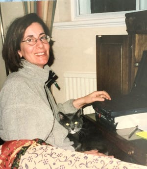 Micky Golden Moore with her cat, Pablo, in 2001 at her London flat.