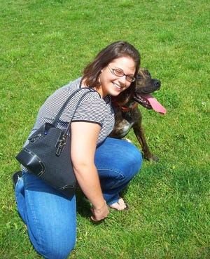 Lindsay Hadden and her dog, Knuckles, in 2008 after one of his favorite activities -- playing ball -- in Colorado Springs, Colorado. Hadden credits the Beyond the Paw Print Pet Loss Support Group for helping her cope after he died in 2017.