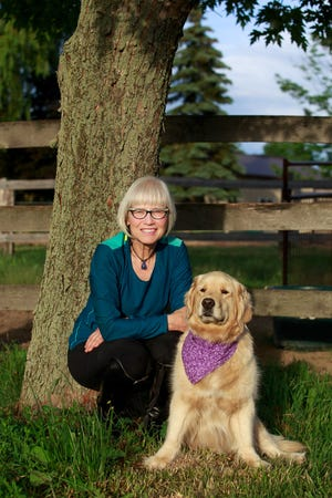 """Colleen Rolland and her dog, Lily Clementine. Rolland describes Lily as her """"heart"""" dog. Lily was euthanized on Sept. 13 in Roland's arms."""