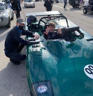 Thumbs up from Ford CEO Jim Farley in his Lola T98 sports racer. Farley has become an accomplished racer while also rising to Ford's top job.