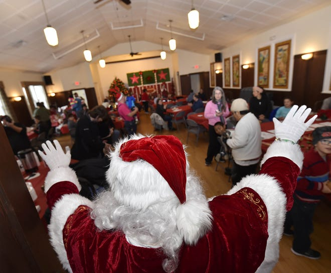 """Because of public health precautions during the COVID-19 pandemic, Santa Claus won't be able to greet children in person like he did at the Door County Library in Ephraim during """"Christmas in the Village"""" in 2017. Instead, people can drive past Santa  and wave to him as Santa sits on the porch of Village Hall the evening of Dec. 5."""