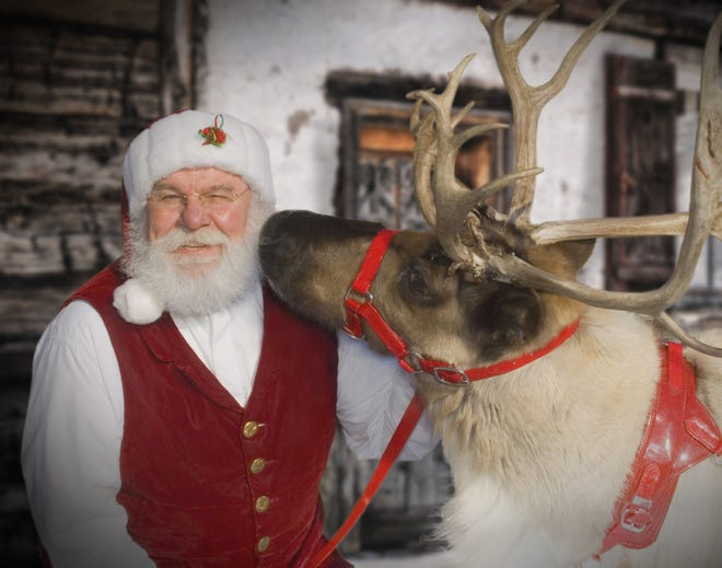 """Santa Claus, or """"G.B. Santa"""" as he's known around these parts, gets a little love from Cupid the reindeer."""