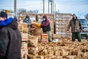 Members of the Blackfeet Food Distribution department, Blackfeet Fire Management and Chief Mountain Hotshots put together over 5,000 Thanksgiving meals which were handed out during a drive-up distribution event on Monday afternoon in Browning, November 23, 2020.