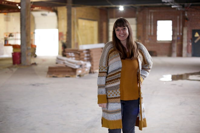 Brittany Whitenack, founder and CEO of Antique Candle Co., stands inside their new office location, 1611 Schuyler Ave., Tuesday, Nov. 24, 2020 in Lafayette.