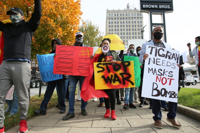 Louisville's Ethiopian community with relatives caught in their country's embattled Tigray region demonstrated downtown Tuesday, calling for U.S. help in ending fighting that is spawning a growing humanitarian disaster and fears of a wider war.