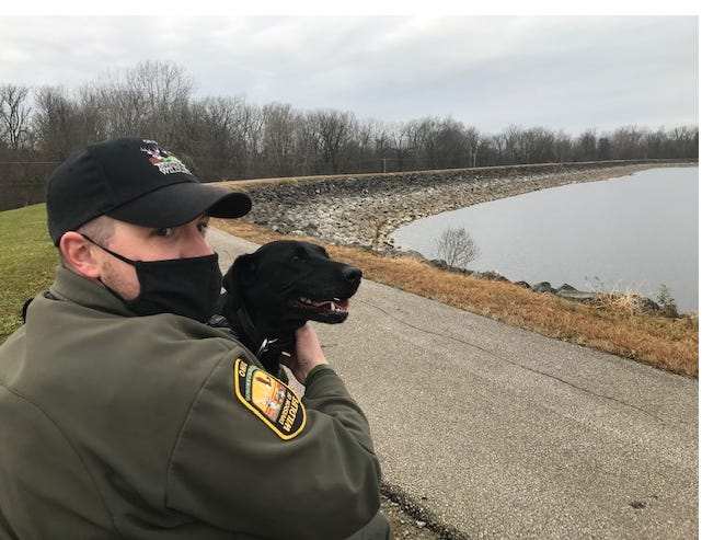 Ohio Wildlife Officer Nathan Kaufmann, assigned to Richland County since October, is one of five wildlife officers in Ohio to have a K-9 partner. May is a black lab trained to find game odors, gun powder, assorted other items and is trained in search and rescue.