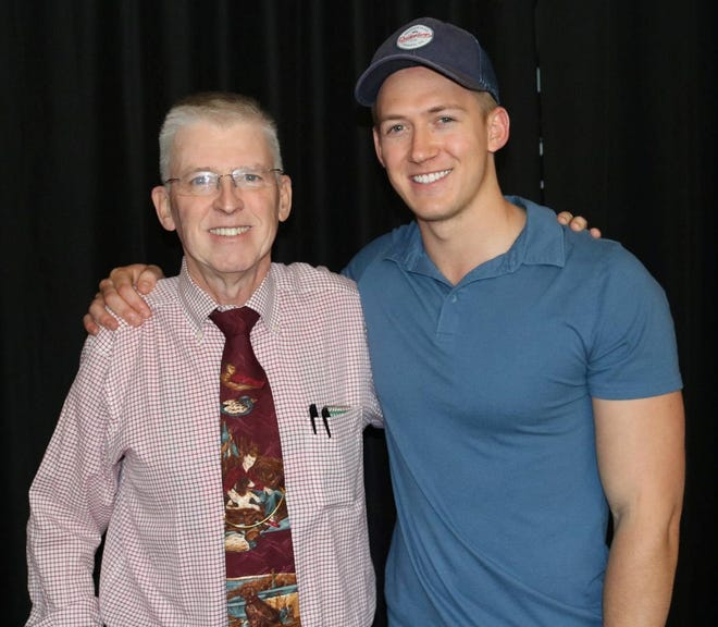 "Former Mansfielder John Klein, a.k.a ""The Encourager,"" left, with Tyler Suddarth, an Emmy Award-winning videographer for the NFL's Houston Texans"