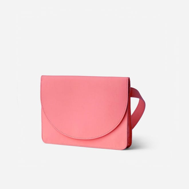 Minor History's Luna Belt Bag in rose leather can be worn multiple ways.