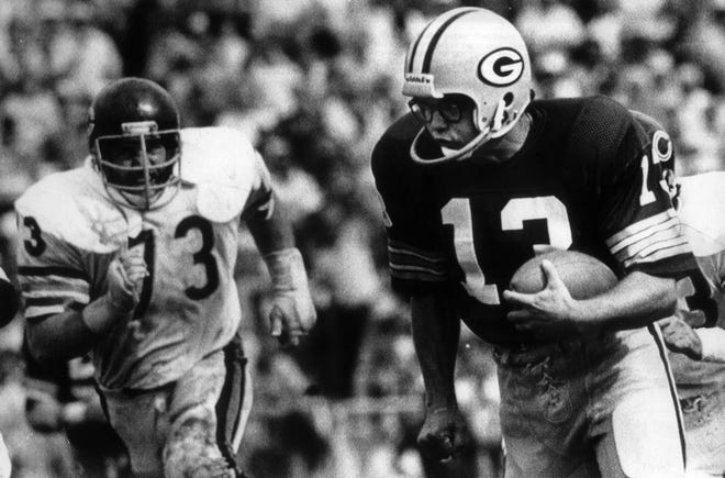 Green Bay Packers kicker Chester Marcol runs for the winning touchdown in overtime after picking up a blocked field goal against the Chicago Bears in the 1980 opener.
