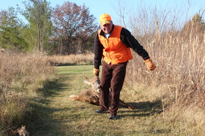 Jim Linstroth of Raymond drags a white-tailed deer killed during a hunt in northern Racine County on opening weekend of the 2020 Wisconsin nine-day gun deer hunting season.
