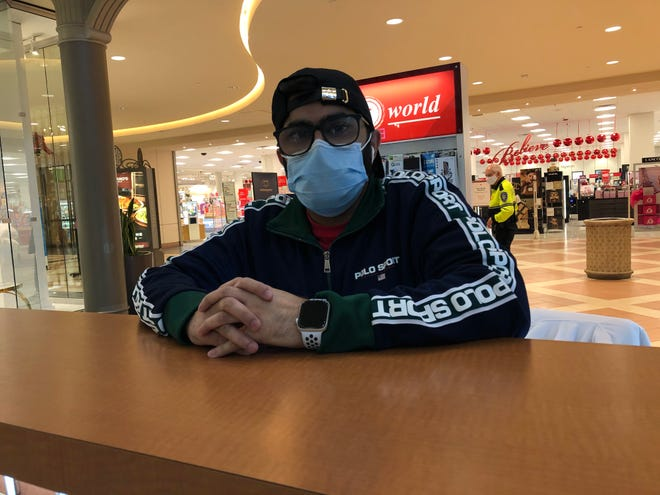 Saqib Javeed, an employee at a kiosk at Mayfair mall, said he and his brother, who was shot in his leg during the Nov. 20 shooting, are pushing for metal detectors at the mall.