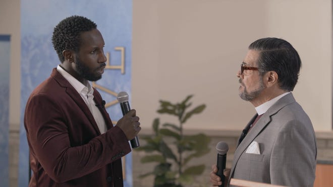 """Andrew Muwonge, left, and David Cecsarini portray pastors in conflict in Next Act Theatre's production of """"The Christians."""""""