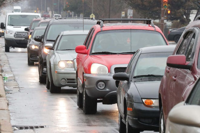 Cars lining up along West Vliet Street as part of a COVID-safe turkey drive held in November of 2020.