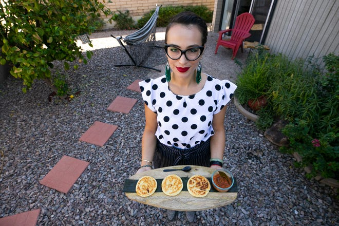 Angelica Urrego makes arepas, a popular food from her native Colombia, at her home in Phoenix. Urrego sells the arepas, which are corn- and cheese-based patties, at a pop-up at The Churchill in downtown Phoenix.