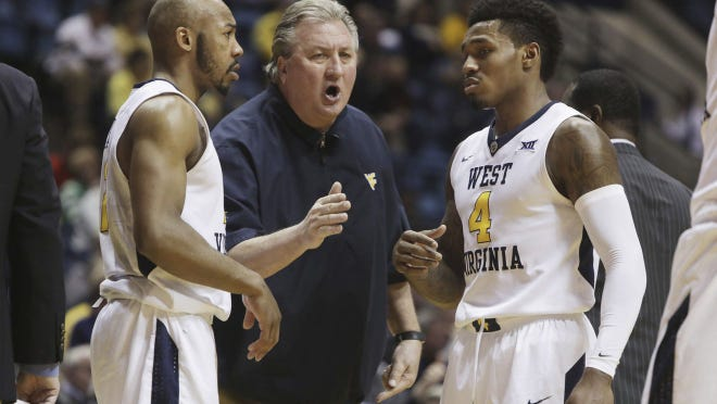 Bob Huggins is the 8th winningest coach in Division I history