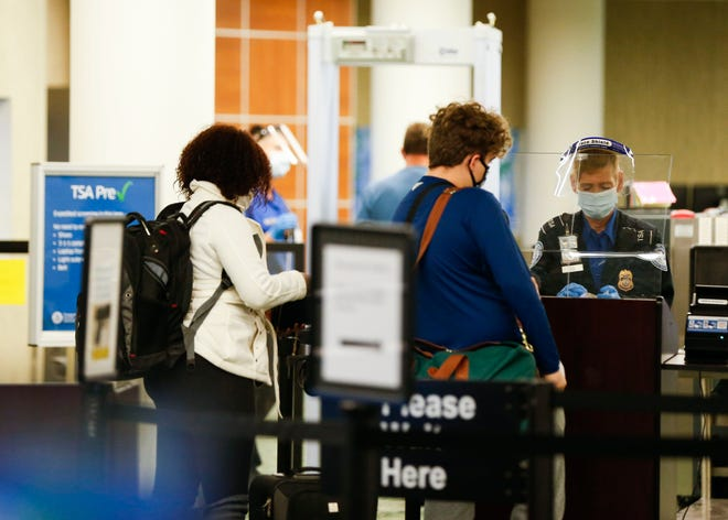 Travelers make their way through airport security at the Springfield-Branson National Airport on Tuesday, Nov. 24, 2020.