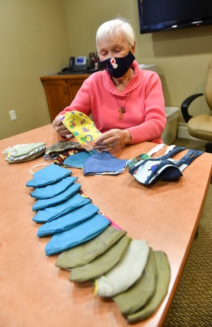 CentraCare volunteer Noreen Plaisance  talks about handmade masks she creates and donates Tuesday, Nov. 24, in St. Cloud. Plaisance has created about 1,700 masks for CentraCare visitor use.