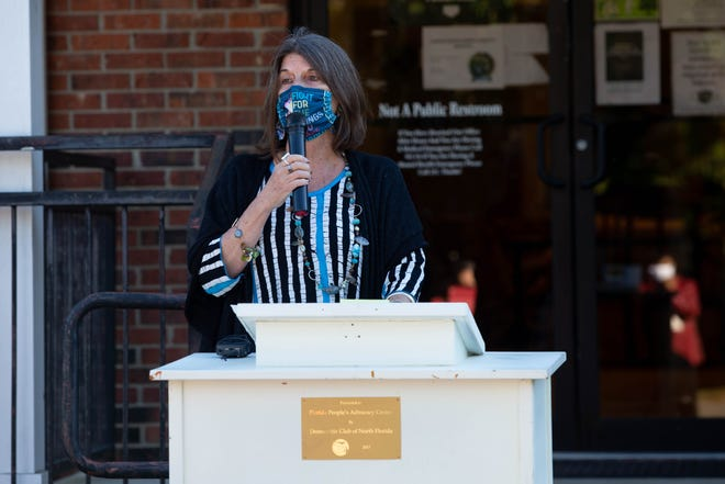 Florida People's Advocacy Center Executive Director Karen Woodall speaks at an event held to reveal two murals of Rosa Parks and Justice Ruth Bader Ginsburg on the exterior walls of the center's building Tuesday, Nov. 24, 2020.