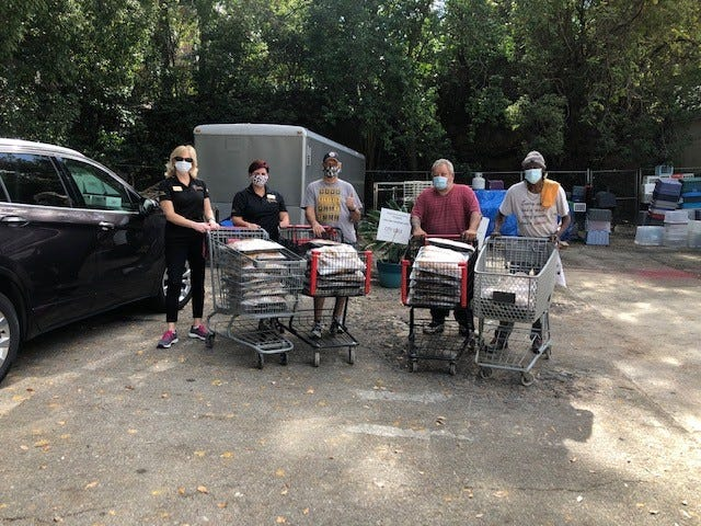 Members of the University Center at FSU staff deliver meals planned for last Saturday's FSU-Clemson game to City Walk Urban Mission.