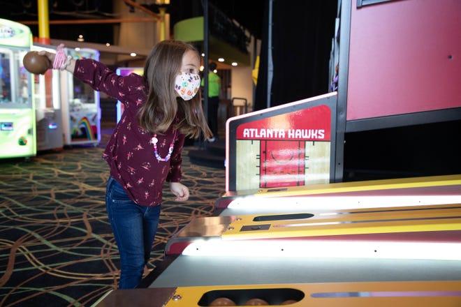 Zoe Feltgen, 6, plays skee ball at District 850 Monday, Nov. 23, 2020.