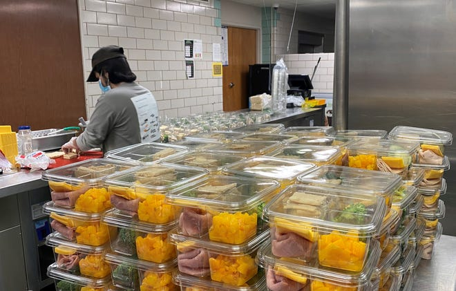 A worker prepares food to hand out in meal boxes for Wichita Falls ISD students as shown in this Nov. 23, 2020, file photo.