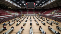 University of Montana students take a socially distanced natural chemistry final exam on Monday inside Dahlberg Arena, the school's basketball arena.
