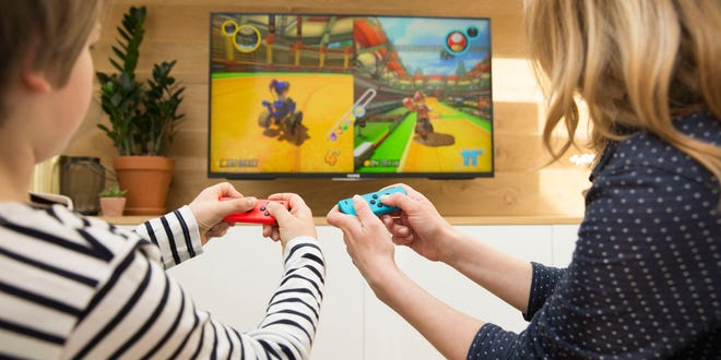 A mother and son play on the Nintendo Switch.