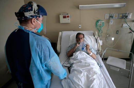 Registered Nurse Daniel Corral works with a COVID-19 patient Thursday, November, 6, 2020 at the El Paso LTAC Hospital.