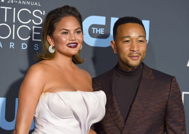 In this Jan. 13, 2019 file photo, Chrissy Teigen, left, and John Legend arrive at the 24th annual Critics' Choice Awards at the Barker Hangar in Santa Monica, Calif.
