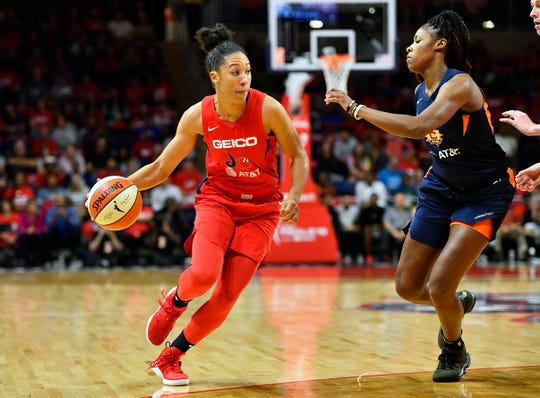 Washington Mystics forward Aerial Powers dribbles as Connecticut Sun guard Bria Holmes defends during game two of the 2019 WNBA Finals at The Entertainment and Sports Arena on Oct. 1, 2019.