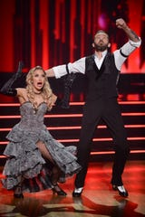 "Kaitlyn Bristowe celebrates her ""Dancing With the Stars"" win with pro partner Artem Chigvintsev."