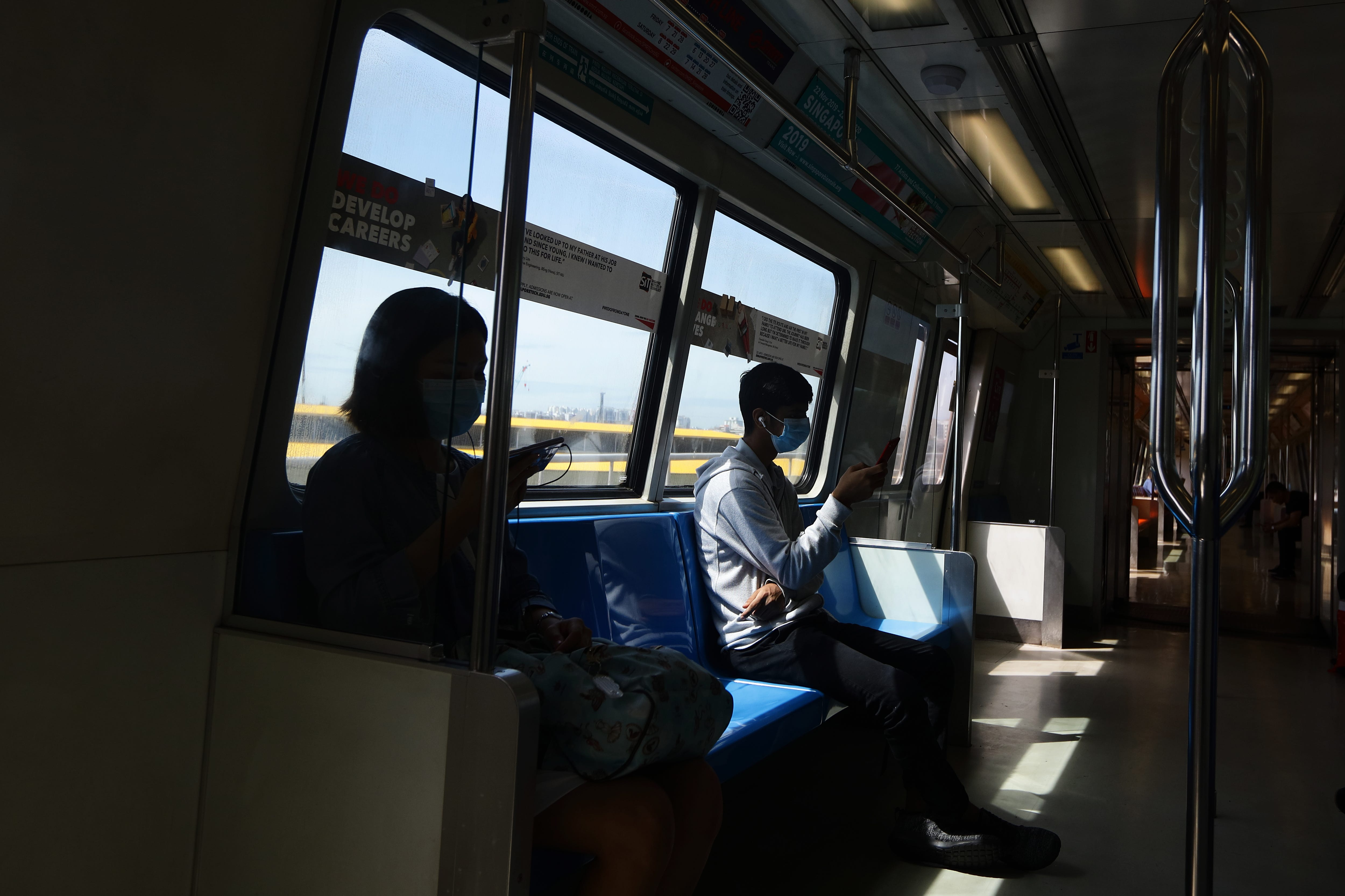 Passengers in Singapore wear protective masks on a train Jan. 30, 2020. Singapore confirmed its first cases of the COVID-19 virus in late January.